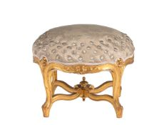 A circular giltwood and button upholstered footstool