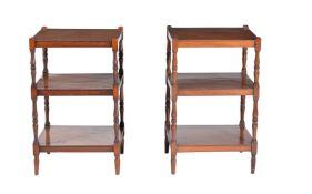 A pair of mahogany three tier side tables