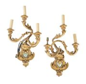 A pair of Italian giltwood and composition three light wall appliques in 18th century taste
