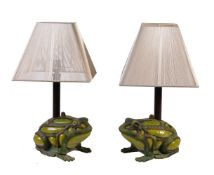 A pair of painted cast iron and reverse painted glass table lamps
