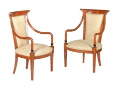 A pair of simulated amboyna and upholstered armchairs