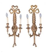 A pair of carved and giltwood twin light wall appliques