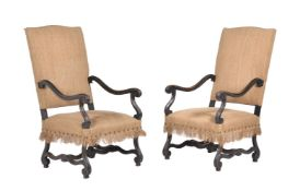 A pair of stained beech and hessian upholstered armchairs, in Continental early 18th century style