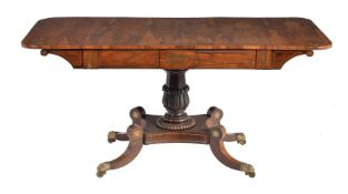 ϒ A George IV rosewood and brass inlaid sofa table