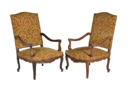 A matched pair of walnut armchairs