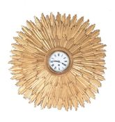 A carved giltwood wall timepiece