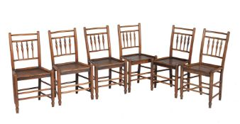 A set of six ash and elm spindle back chairs
