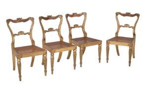A set of four George IV giltwood side chairs