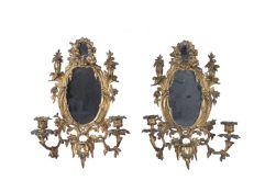 A pair of gilt metal twin light girandoles in Rococo taste