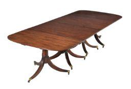 A mahogany four pillar dining table
