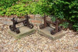 A pair of substantial Victorian wrought iron and limestone mounted boot scrapes