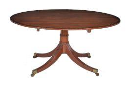 ϒ A Regency mahogany and rosewood banded breakfast table