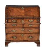 A George I walnut and feather banded bureau
