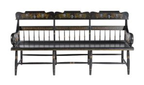 An ebonised, parcel gilt and painted chair back settee or hall bench