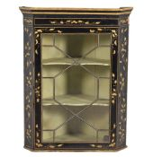 A George III black and gilt japanned corner wall cupboard