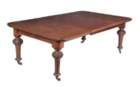 A Victorian mahogany extending dining table
