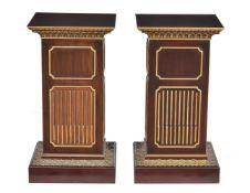 A pair of stained wood and parcel gilt pedestals