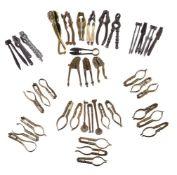 ϒ A collection of 39 various brass and pewter nutcrackers and other culinary implements