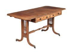 ϒ A mahogany and ebony inlaid sofa table in Regency style