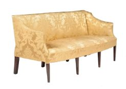A mahogany and yellow silk upholstered settee