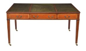 A mahogany and satinwood banded library table, in George III style