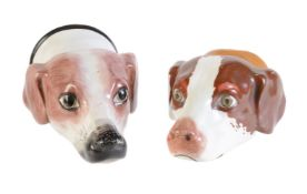 Two Staffordshire pottery hounds head stirrup cups