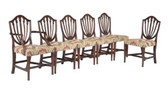 A set of sixteen mahogany dining chairs in George III style