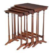 A nest of four mahogany quartetto tables