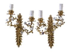 A pair of gilt metal and porcelain mounted twin light wall appliques in Louis XV style