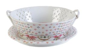 An English porcelain Chinese Export style pierced two-handled basket and stand of New Hall/Factory X