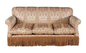 An upholstered three seat sofa in Victorian style