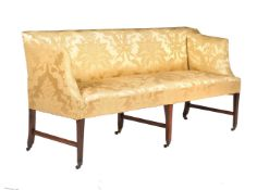 A mahogany settee in George III style