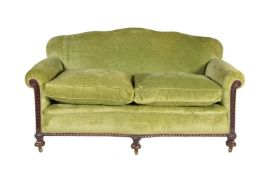 A walnut and green velvet upholstered two seat sofa