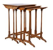 A nest of three Sheraton Revival satinwood and polychrome painted tables