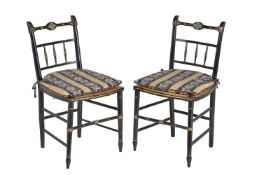A pair of Regency black painted side chairs
