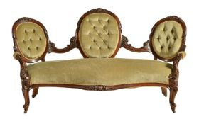 A mid-Victorian mahogany and upholstered settee