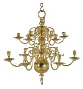 A Dutch or English cast and turned brass twelve light chandelier in 18th century taste