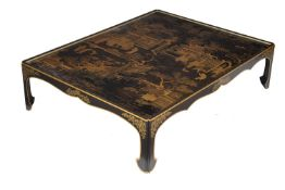 An ebonised, black lacquer and gilt Chinoiserie decorated low table