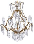A gilt metal and cut glass hung eight light chandelier in Louis XV style