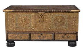 A Zanzibar metal mounted and studded hardwood coffer