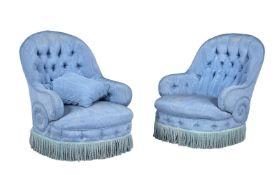 A pair of Victorian walnut and blue watered silk upholstered nursing chairs