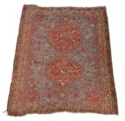 A group of three rugs