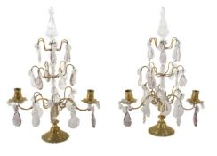 A pair of cut glass and brass twin light lustre candelabra in 18th century taste