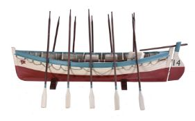 A model of a life boat with detachable rudder and oars