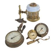 A collection of three full size steam pressure gauges