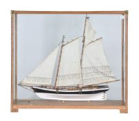 A cased model of the racing yacht 'America'