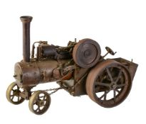 A well-engineered scratch-built model of an approximate ¾ inch to 1 foot scale live steam traction e