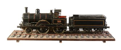 A well-engineered model of a 3 ½ inch gauge 2-4-0 tender locomotive No 619 'Mabel'