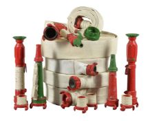 A collection of five naval fire hoses and three detachable fire nozzles