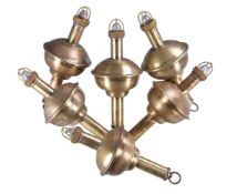 A collection of six polished brass marine floats